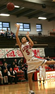 LHS junior Jasmyn Turner tries fot a basket during Friday night&#39;s game against Olathe East. The Lions defeatede the Lady Hawks 57-40.