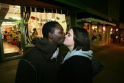 Mike Carson and Holly Hatfield, of Kansas City, say the perfect kiss requires a balance of not too much or too little.