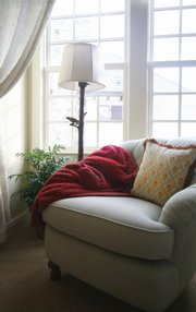Tactile additions to your home, like a warm, cozy throw rug, add a sensual element.