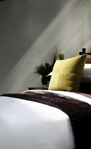 Adding tactile elements to your home, such as soft pillows and throws, helps make it a pleasant retreat.