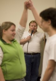 Kevin Oneslager, Lawrence, calls the steps during a Lone Star Square Dance Club practice Wednesday, Feb. 4, 2009, at the Dreher Building of the Douglas County Fairgrounds.