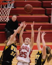 Lawrence High junior guard Haley Parker battles for a rebound with Shawnee Mission West sophomore guards Lizzy Jeronimus, left, and Whitney Knightly during the second half Friday, Feb. 13, 2009 at Lawrence High.