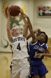 Free State&#39;s Ashleigh Allam (4) tries to secure a defensive rebound during the game against Leavenworth Friday, Feb. 13, 2009, at Free State High.