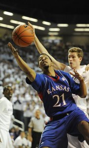 KU's Markieff Morris goes for rebound against Kansas State in the first half at Bramlage Coliseum on Saturday, Feb. 14, 2009.