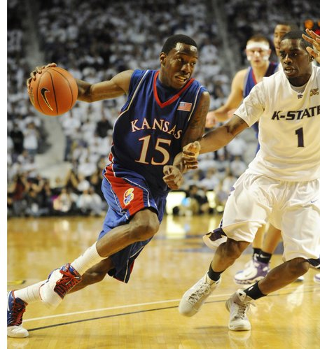 Kansas guard Tyshawn Taylor puts a move on KSU's Fred Brown on Saturday, Feb. 14, 2009 at Bramlage Coliseum in Manhattan.