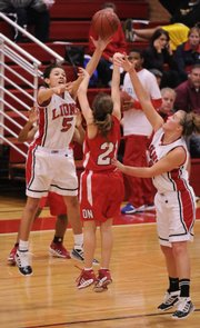 Nick Krug/Journal-World Photo.Lawrence High junior guard Jasmyn Turner tips a pass by Olathe North senior guard Haley Downing as senior guard Taylor Bird assists with the trap during the second half Tuesday, Feb. 17, 2009 at Lawrence High.