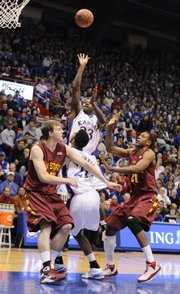 Kansas guard Mario Little puts up a floater over Iowa State defenders Jamie Vanderbeken, left, and Craig Brackins during the first half, Wednesday, Feb. 18, 2009 at Allen Fieldhouse.