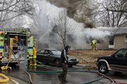 Firefighters battle the blaze Friday at 1946 Clifton Court near 19th and Ousdahl Streets.