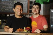 Robert Krause, left, and Simon Bates — purveyors of gourmet burgers and fries at The Burger Stand.
