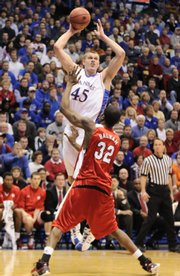 Kansas center Cole Aldrich elevates for a shot over Nebraska forward Chris Balham during the first half, Saturday, Feb. 21, 2009 at Allen Fieldhouse.