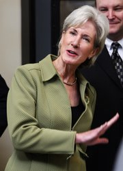 Gov. Kathleen Sebelius talks with store owners during a grocery store opening in this Feb. 11 file photo in Greensburg. Sebelius' record on health care is under scrutiny as she is now a leading candidate for Health and Human Services secretary.