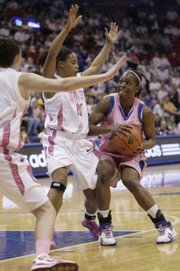 Kansas' Danielle McCray (4) looks for space to shoot over Iowa State's Denae Stuckey (10) during the game Sunday, Feb. 22, 2009, at Allen Fieldhouse.