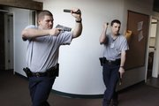 Police recruits Samuel Hiatt and Christopher Hatfield go through training exercises at the Old Fire Station No. 4 on Monday.