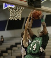 Free State's Eric Watson (34) takes the ball strong to the basket against Olathe Northwest Tuesday, Feb. 24, 2009, at Olathe Northwest High School.