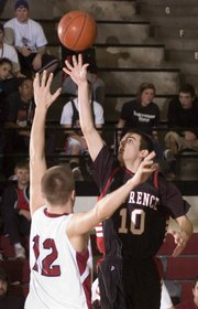 Junior Drake DeBiasse (10) skies over David Jorgenson for two. LHS boys beat Shawnee Mission North 57-40 Tuesday, Feb. 24.