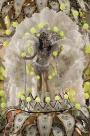 A dancer performs atop an Imperatriz samba school float Tuesday at the Sambadrome in Rio de Janeiro.