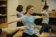 Monica Schuman stretches along with others at the Yoga Center of Lawrence, 920 Mass.