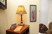 A piece of American Indian artwork hangs on the wall in Lutz's home. She often buys works from the Indian Art Market for her home.