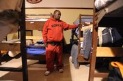 Joe Hooks, 52, looks over his bunk Thursday at The Salvation Army, 946 N.H. The 42-bed shelter will close on May 1.