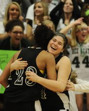 Free State sophomore forward Paige Rothwell hugs junior forward Chantay Caron, 23, after the Firebirds&#39; comeback victory over Lawrence High Friday, Feb. 27, 2009 at Lawrence High.