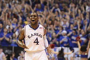 Kansas guard Sherron Collins smiles after drilling a three-pointer against Missouri during the first half Sunday, March 1, 2009 at Allen Fieldhouse.