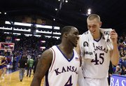 Kansas teammates Sherron Collins, front, and Cole Aldrich are all smiles leaving the court following the Jayhawks' win over Missouri Sunday, March 1, 2009 at Allen Fieldhouse.