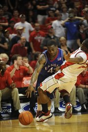 KU's Sherron Collins tries to get by a Texas Tech defender during the first half, Wednesday, March 4, 2009 at United Spirit Arena in Lubbock, Texas.