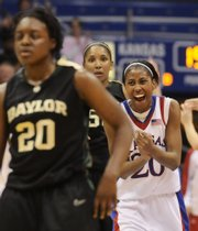 Kansas guard Sade Morris celebrates as Baylor guard Terran Condrey watches time run out late in the second half Wednesday, March 4, 2009 at Allen Fieldhouse.