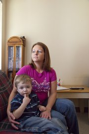 Jessica Rose and her son Jadan in the apartment they have been moved to after discovering their previous apartment was infested with mold. There is a lack of federal regulation to protect mold victims.