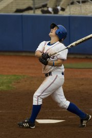 Senior Val Chapple pops one up in the fourth inning. The Kansas softball team played North Dakota State Friday at home.