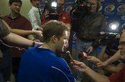 Senior KU quarterback Todd Reesing talks to the media Friday during a spring football news conference.