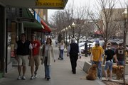 Shoppers browse along Massachusetts Street.