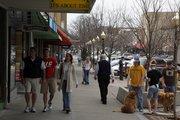 Shoppers browse along Massachusetts Street.