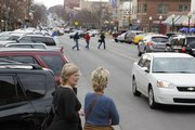Shoppers browse along Massachusetts Street. Downtown Lawrence is widely considered a gem of the city.