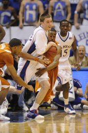 KU guard Brady Morningstar comes up with a loose ball against Texas on Saturday, March 7, 2009 at Allen Fieldhouse.