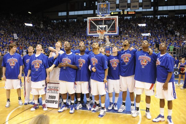 The 2008-09 Kansas men's basketball team checks out the Jumbotron in Allen Fieldhouse after clenching the Big 12 championship with a win over Texas on Saturday, March 7, 2009 at Allen Fieldhouse.