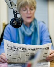 Lawrence resident and Audio-Reader volunteer Kris Shields delivers the news for Kansas Audio-Reader.