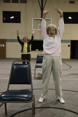 Marge Glenn, front, reaches for the sky during a morning workout session in March 2009 at the First Baptist Church, 1330 Kasold Drive. Participants in the workout session have completed a course called Personal Actions To Health.