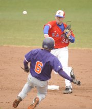 James Stanfield (38) takes out Missouri Valley's Wes McClellan (6) in a double play.