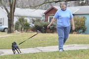 Debbie Shirar has been waiting for almost 900 days to find out whether she will get disability insurance. In the meantime she is living with a friend and with the help of some minimal state funding. Shirar walks with her friend's dog near their east Lawrence house.