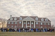 Friends and family gather outside Sigma Alpha Epsilon to remember Jason Wren, 19, who died Sunday, March 8.