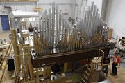 Workers at Reuter Organ Co. work on an instrument slated for delivery to a church in Texarkana, Texas. The company has weathered recessions before, and leaders say it is poised to emerge from this one, too.