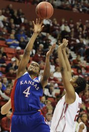 Kansas forward Danielle McCray shoots over Oklahoma forward Amanda Thompson during the first half Friday, March 13, 2009 at the Cox Convention Center in Oklahoma City.