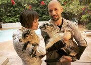 "Neil Strauss (who holds Lady while girlfriend Ghita Jones holds Thumper) is enjoying good times while they last, but bad times won't catch him off guard. Strauss' latest work is ""Emergency: This Book Will Save Your Life."""