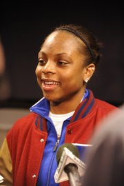 Kansas' Danielle McCray visits with the media after the Jayhawks learned Monday they were headed to the Women's NIT.