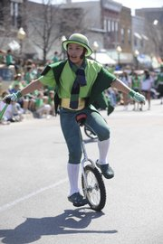 Owen Tuckfield, 11, of Baldwin, displays his unicycle skills to the crowd at the St. Patrick's Day Parade.