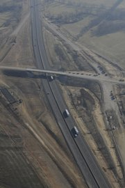 The turnpike passes under County Road 1 north of Eudora as crews work to complete the new intersection.