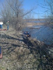 Rescue crews work to help a man from the water at Bismarck Lake north of Lawrence on Thursday afternoon.