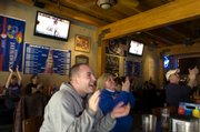Isaac Gardner and his mother, Susan Gardner watch a Kansas University basketball game at Jo Shmo's, 724 Mass.