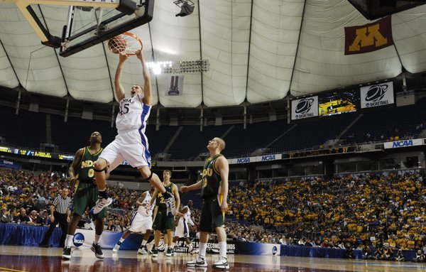 Kansas center Cole Aldrich delivers a dunk over North Dakota State defenders Dejaun Flowers, left, and Ben Woodside during the first half Friday, March 20, 2009 at the Metrodome in Minneapolis.